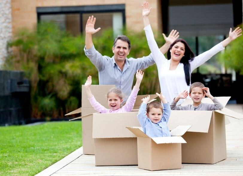 12824441 - happy family in cardboard boxes moving house