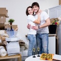 7917584 - happy beautiful couple embracing in their new flat